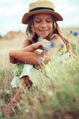 Girl in spring field — Stock Photo