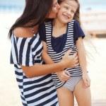 Happy family at beach — Stock Photo