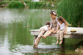 Children near pond — Stock Photo
