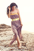 Fashion model at the beach — Stock Photo