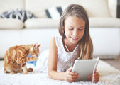 Pre teen girl with tablet pc — Stock Photo