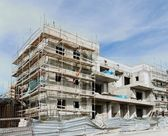 Three-storeyed apartment building under construction — Stock Photo