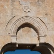 Bas-relief above the Dung gate in the Old City of Jerusalem - Stock Photo