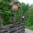 Traditional lath fence around a farmer's house with clay pots on top of stakes in open air museum, Kiev, Ukraine — Stock Photo