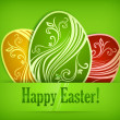 Painted Easter eggs on green & text — Stock Vector