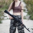 A military woman with an automatic rifle ak-74 - Stock Photo