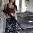 A military woman with an automatic rifle ak-74 — Stock Photo #12813533