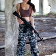 A military woman with an automatic rifle ak-74 — Stock Photo #12813537