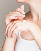 A woman cares about her hands — Stock Photo