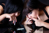 Girls are sniffing cocaine (imitation) — Stock Photo