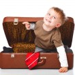 A funny boy with sombrero is in the suitcase — Stock Photo