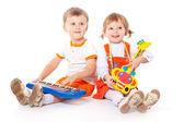 Kinderen met speelgoed in de studio — Stockfoto