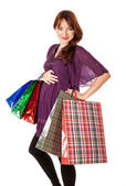 Pregnant woman with bags — Stock Photo