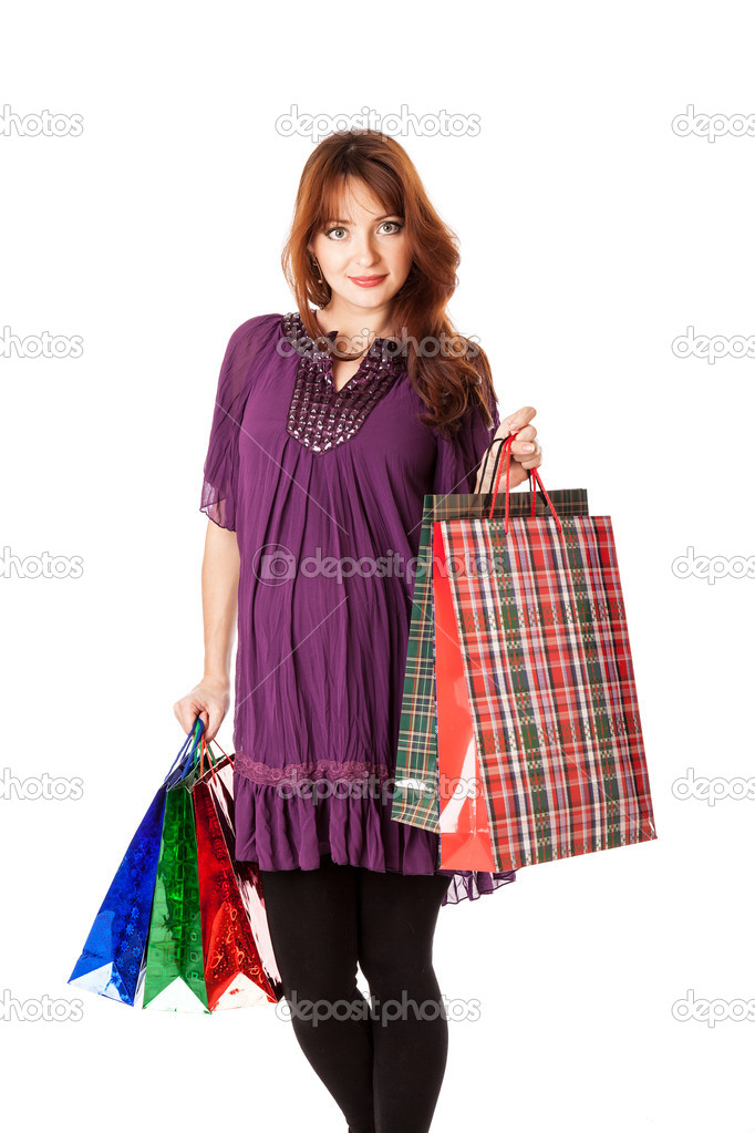 Pregnant woman with bags. Isolated on white — Stock Photo #14104590