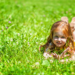 A smiling girl is lying on the meadow — Stock Photo