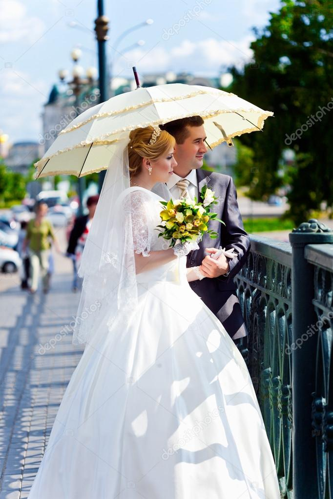 Young blonde bride and groom in walking the park  Stock Photo #14747535
