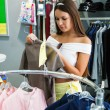 Anl young woman is in the shop — Stock Photo #16766093
