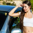 A woman is near the car — Stock Photo #16766123