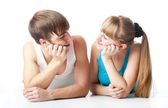 Sports couple is lying in the studio — Stock Photo