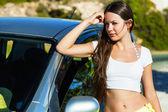 A woman is near the car — Stock Photo