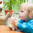 Little girl is drinking milk — Stock Photo