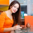 A beautiful woman is drinking in the kitchen — Stock Photo #18963001