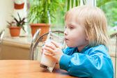 Little girl is drinking milk — Stock Photo