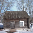 Wooden house in winter — Stock Photo #27093501