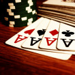 Four aces and poker chips — Stock Photo #50357315