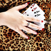 Hands holding four aces — Stock Photo