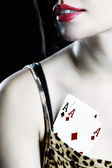 Aces in woman bra — Stock Photo