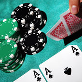 Pair of aces and poker chips — Stock Photo
