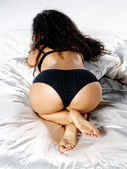 Perfect booty on silk sheets. — Stock Photo