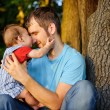Son kissing his father — Stock Photo #12275986
