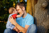 Son kissing his father — Stock Photo