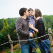 Happy parents with son — Stockfoto