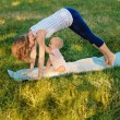 Mother and her daugther practice yoga — Stock Photo