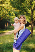Mother and her daugther going for yoga class — Stock Photo