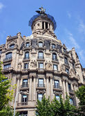 Old beautiful architecture at famous Passeig de Gracia street (E — Stock Photo