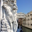 Bridge of Sighs and Marble statue of the Doges Palace, Venice, Italy — Stock Photo #28168219