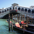 VENICE-JUNE 23:Rialto Bridge on June 23,2013 most visited and most photographed bridge in Venice, opened in 1591. For nearly three hundred years, it was the only way to cross the Grand Canal on foot — Stock Photo