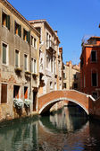 Canal and old bridge in Venice — Stock Photo