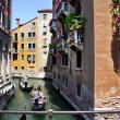 VENICE-JUNE 23:  Gondolier rides gondola on the canals of Venice — Stock Photo