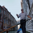 VENICE-JUNE 23: Gondolier rides gondolon canals of Venice — Stock Photo #29319685