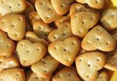 Heart shaped crackers background — Zdjęcie stockowe