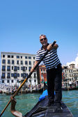 VENICE-JUNE 23: Gondolier rides gondola on the Grand Channel on — Stock Photo