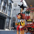 Souvenirs Pinocchio wooden italian marionette in Piazza del Duom — Stock Photo #30339991