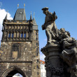 Stock Photo: Tower and statue at the Charles Bridge in Prague, Czech Republic