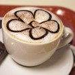 Cappuccino or latte coffee cup with art foam — ストック写真