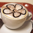 Cappuccino or latte coffee cup with art foam — Stockfoto